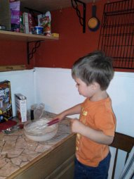 Mr. right before his third birthday mixing up some pancake batter.