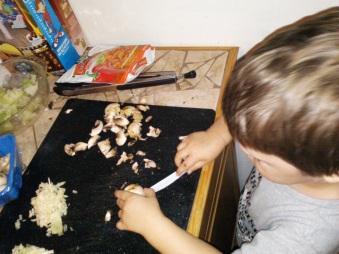 Mr. cutting mushrooms - few weeks after his third birthday.